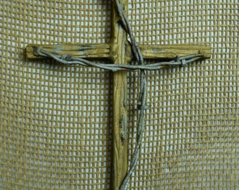 Iron wall cross with barb wire