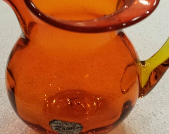 "Vintage Orange Amberina Blown Glass Pitcher by Rainbow Glass of Huntington, W.V. 6"" tall and wide. Applied handle. No damage. Very Clean."