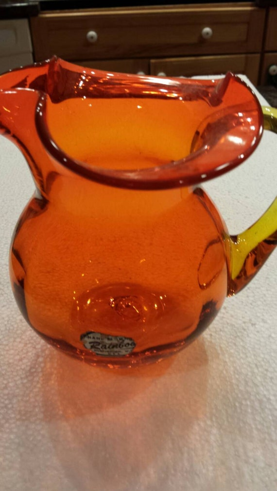"""Vintage Orange Amberina Blown Glass Pitcher by Rainbow Glass of Huntington, W.V. 6"""" tall and wide. Applied handle. No damage. Very Clean."""