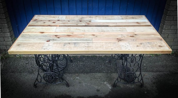 Reclaimed timber Table with cast iron sewing machine base
