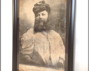 Aged reproduction framed print of a Victorian era Bearded Lady.