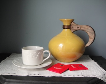 Vintage Red Wing Yellow carafe with wooden handle