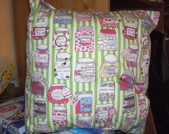 home made cushion with jars of sweeties on
