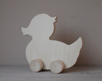 Wood duck / educational toy / rolling duck