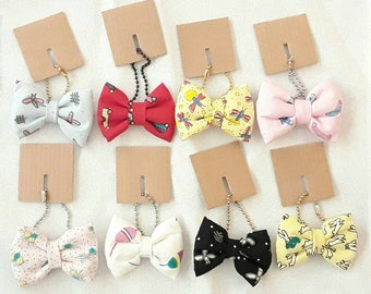 Bow with chain, key ring or pendant.