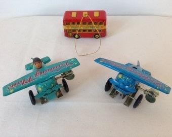 Vintage wind up tin toys