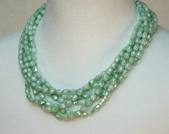 Eight strand necklace in water green German glass