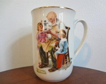 Norman Rockwell The Toymaker Vintage Souvenier Coffee/Tea Mug 1982