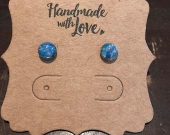 7mm blue fire opal stud earrings on surgical steel posts. Hypoallergenic