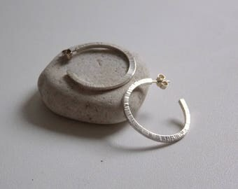 Large Creole in money. Rings of ears with an effect of forging and hammering.