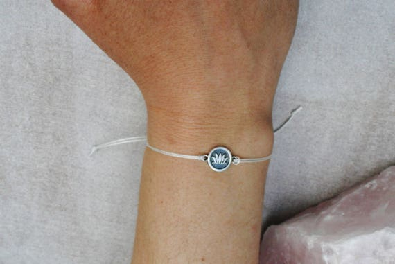 Sterling Silver Lotus Bracelet On White Nylon Cord