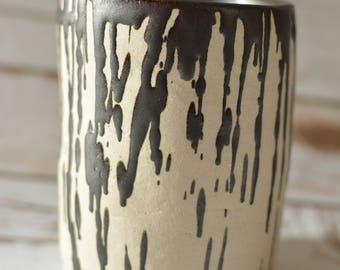 Stoneware cylinder with dripped glaze