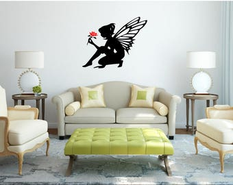 Fairy sat holding flower wall art or sticker
