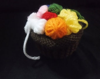 Hand knitted tiny adorable basket of yarn