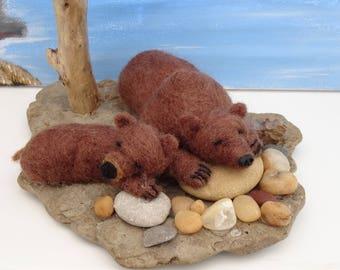 Sleeping Bears on stone and pebbles
