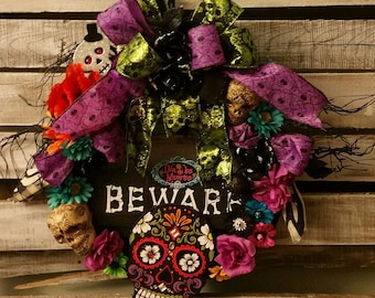 "A ""Day of the Dead"" Wreath with Skulls and Bright Flowers"