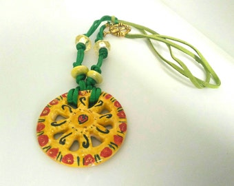 """Maxi necklace """"Trinacria"""" with big Caltagirone's pottery wheel, silk and suede cord and T bar latch"""