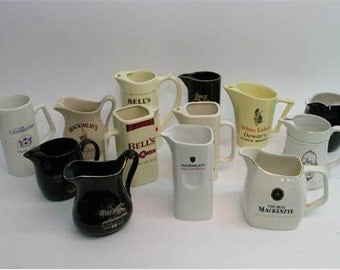 nice collection of bar mania water jugs approx 14 of them