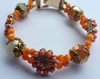 Peach and gold flower beaded bracelet with fold over magnetic clasp
