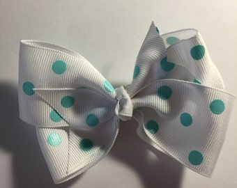 Turquoise polka dotted hair bow