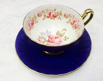 Aynsley cobalt blue teacup and saucer with garden roses.