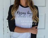 Raising Boys Loving Life © THE ORIGINAL | Boy Mom Shirt | Mom Life Shirt | Women's Raglan T Shirt | Mother's Day Gift | Trendy | Mom of Boys