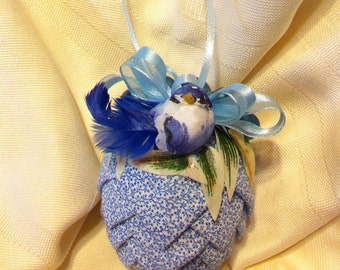 Blue on white floral print fabric pinecone ornament.