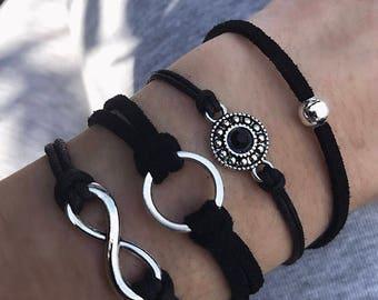 Silver charm bracelet on black cord / infinity / loop / single bead / round crystal