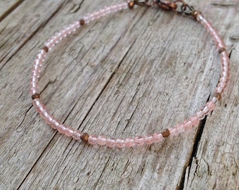 delicate and thin semi-precious stone bracelet made of pink cherry quartz and faceted Hematite beads, copper