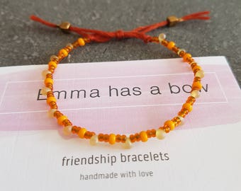 Filigree Friendship Bracelet made of small beads in Orange and rust brown