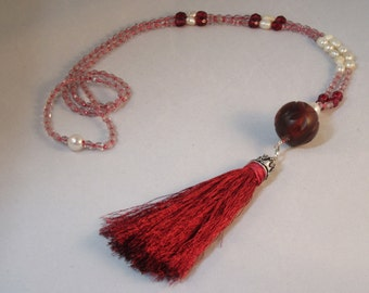 Beautiful handmade red and white silk tasseled beaded necklace.