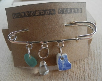 Kilt pin with sea glass, sea pottery and a vintage crystal droplet.