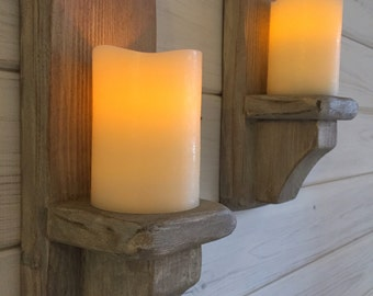 Pair of cream washed candle sconces.