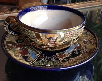 a cup and saucer satsuma earthenware