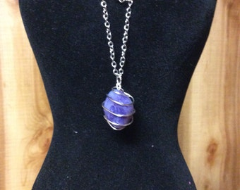 "Amethyst wrapped in silver with 17"" chain"