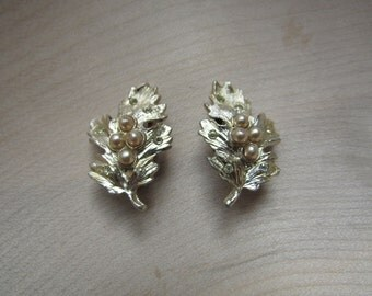 Leaf shaped clip on earrings with pearl detail