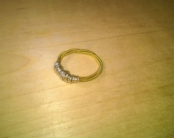 Ring made of a guitar string. Wrapped in silver wire.