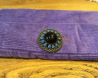 Blue glass brooch