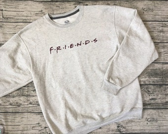 "Friends Title Sweatshirt. From the popular TV show ""Friends"" get this cozy show name sweatshirt! Light heather grey shirt with maroon"