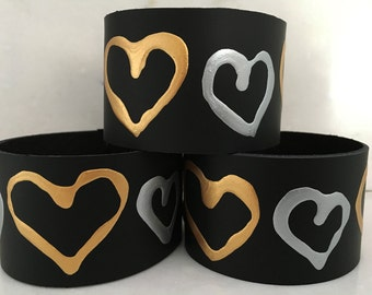 These unique one of a kind hand painted leather bracelets with gold and silver hearts are beautiful, comfortable and affordable.