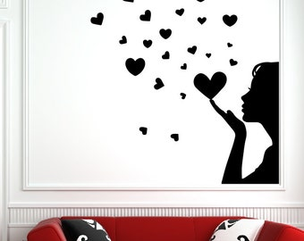 Girl blowing hearts vinyl wall decal home decor a58