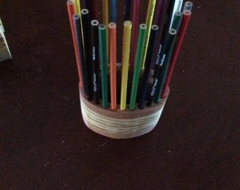 Colored pencil holder. Handmade, wooden, holds 24 colored pencils. Oval shaped.