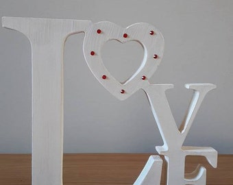 Tumbling love wooden sign