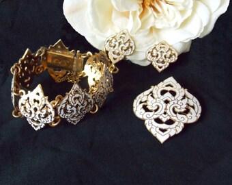 Siam gold white enamel set, brooch, bracelet and earrings, 1950s