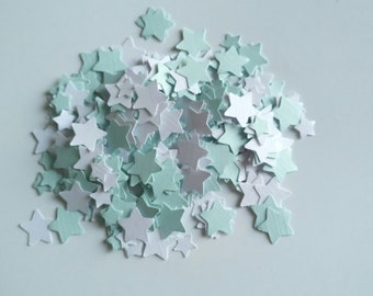 Handmade star shaped table confetti in pastel blue and white