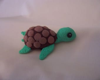 Green and brown whimsical turtle handmade from polymer clay