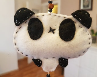 Panda made of felt to the craft