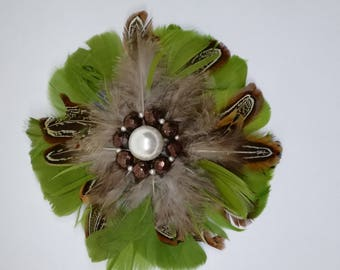 Brooch with glass beads and feathers
