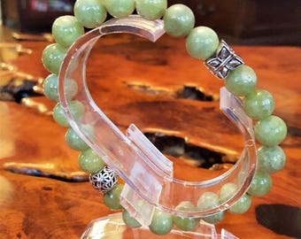 10 mm Genuine Peridot Bead Bracelet