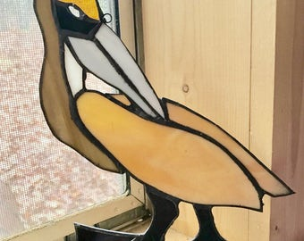 Stained glass canadian pelican suncatcher .